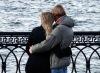 couple hugging on bridge